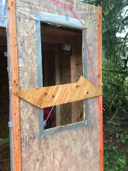 Using a plywood scrap to prevent the window from falling through