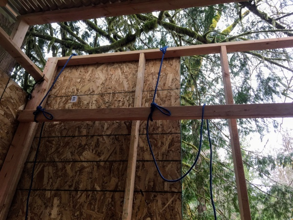 First sheet of OSB for the upper floor front wall.