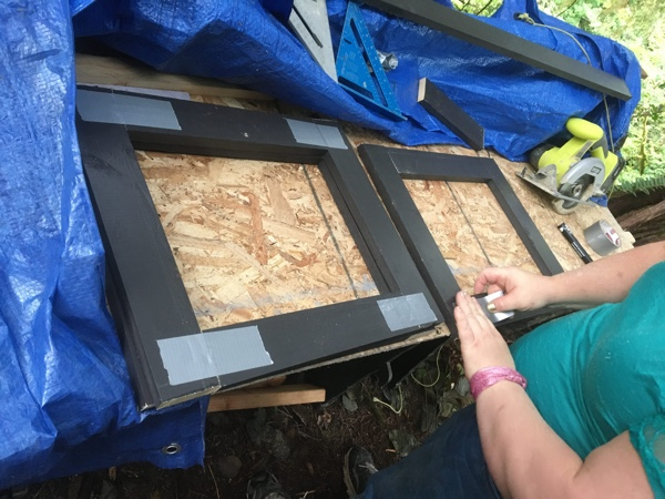 Amber prebuilt six matching frames to trim out the six upper-floor windows.