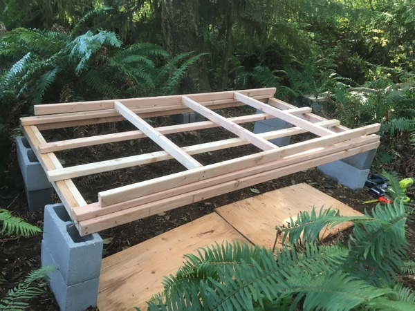 I removed the two inner studs from the long sides so I could attach the three joists that will hold the flooring. I placed extra studs underneath to create a temporary work surface.